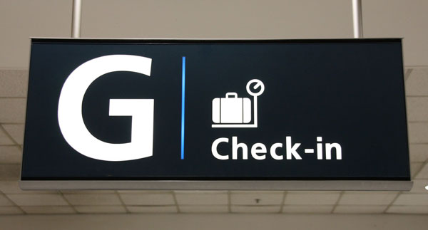 Check-in sign at Sydney Airport
